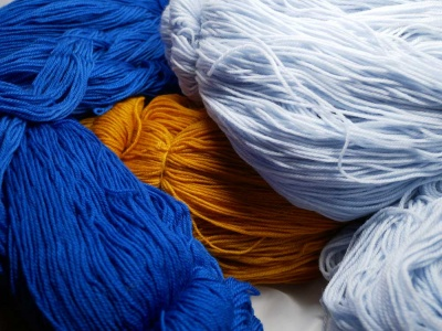 Our Status, Royal, and Tumeric yarns.