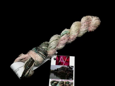 Beaded Silk & Sequins skeins dyed in Cherry Blossoms.