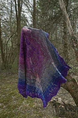 This is the shawl in Blue Moon, though on my monitor this has a bit more red-violet to it than the colorway actually has.
