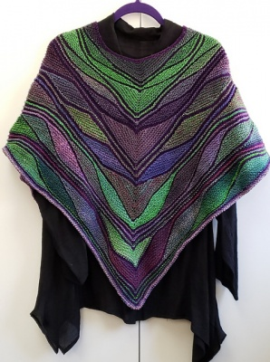 This and each following photo shows a poncho as knit by BarbAnn, all © BarbAnn Pappas