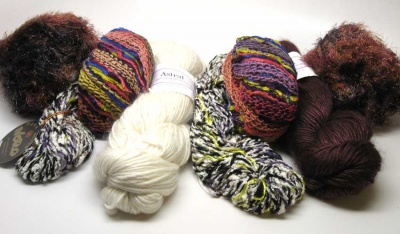 Though this shows two BeBop balls, two Aria, and two skeins of the Noro, each kit will have one of each.