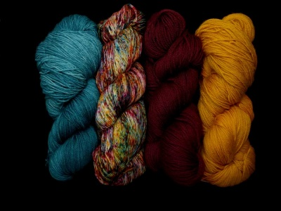 Our yarns:  left to right you see Teal, Carnival, Oxblood, Tumeric