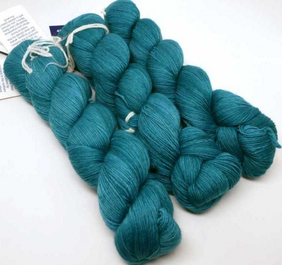 Teal Feathers (your kit will have two skeins, not the 3 shown here).