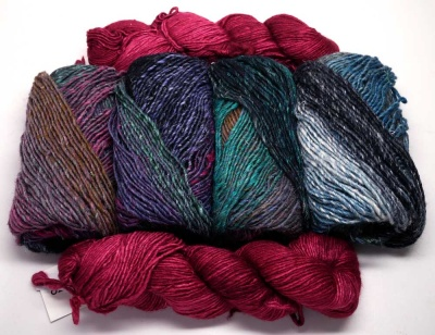 Showing the Silky Merino in Rupestre plus four skeins of the Noro Silk Garden #413.