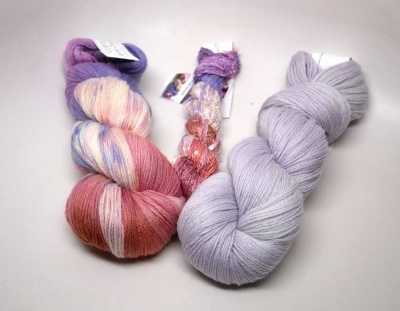 Pink Sands in the Merino Cloud and Beaded Silk & Sequins; #312 is the almost-solid skein.