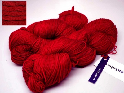 Ravelry Red:  definitely a true red (think Christmas red).