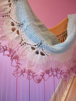 Following are photos of the original shawls as knit by the designer.