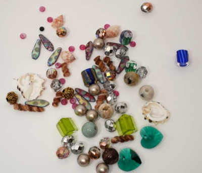 We have a huge (!) assortment of possibilities for an expanded set of beads, including crystals, pearls, shell, and all sorts of beauties.