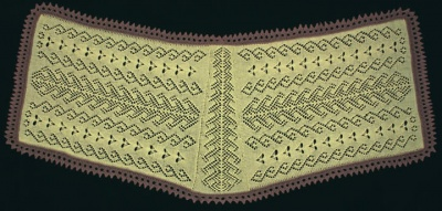 Here is the original stole that Dorothy knit, laid out to show the wedge-shaped panel at back and two