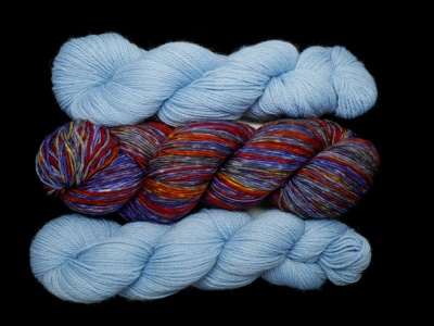 Our kit will include one skein of the Uneek Fingering + one skein of the Canopy fingering (if you would like two, contact me and we'll work it out).
